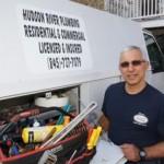 Plumer Dan Cabiroy opening tool box on his truck